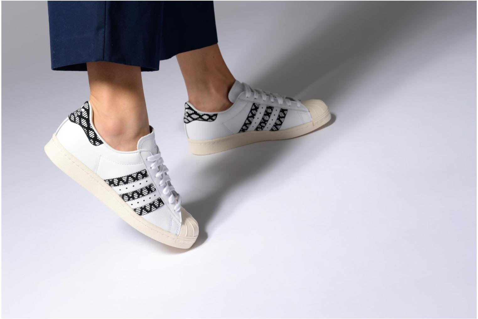 Trainers Adidas Originals Superstar 80S W Black view from underneath / model view