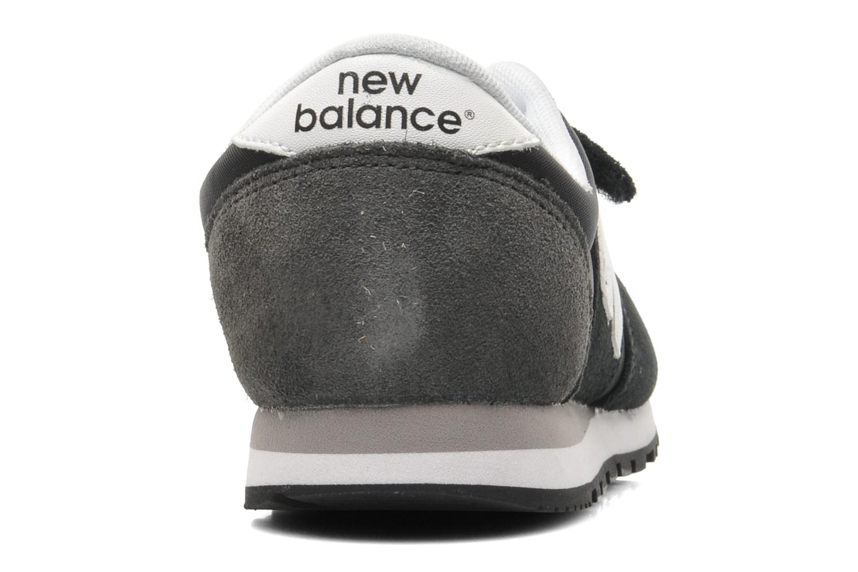 Deportivas New Balance KE420 J Negro vista lateral derecha
