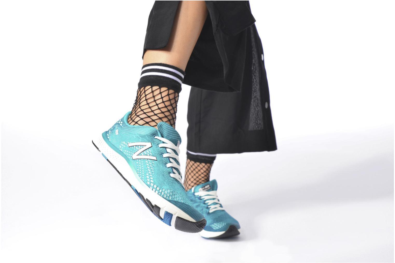 Chaussures de sport New Balance WXAGL Bleu vue bas / vue portée sac